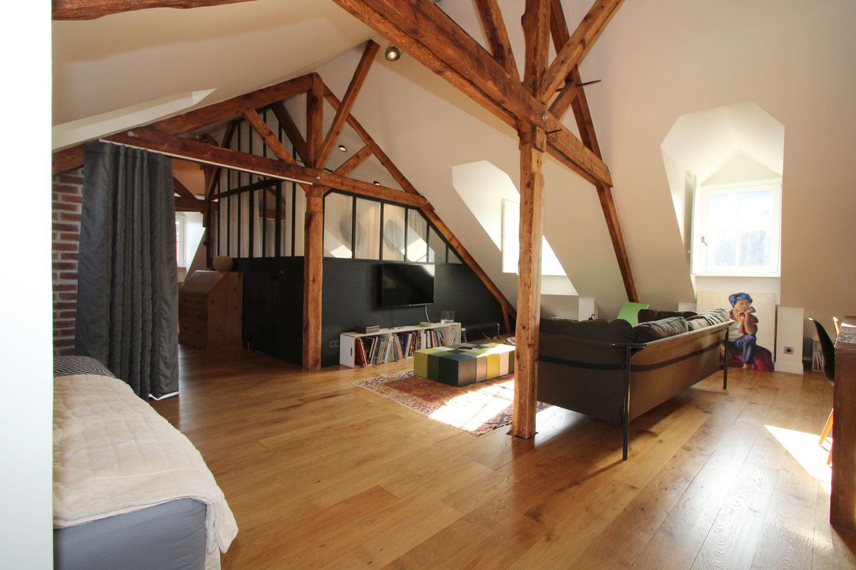 Salon avec canapé de notre appartement de Vannes en location.